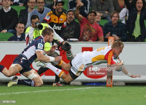 Gareth Anscombe of the Chiefs dives to score his second try during the round 12 Super Rugby match between the Rebels and the Chiefs at AAMI Park on...
