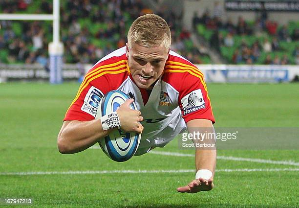 Gareth Anscombe of the Chiefs dives to score his teams first try during the round 12 Super Rugby match between the Rebels and the Chiefs at AAMI Park...