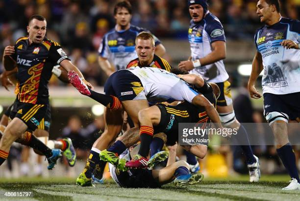 Gareth Anscombe of the Chiefs is tackled by Joe Tamane of the Brumbies during the round 11 Super Rugby match between the Brumbies and the Chiefs at...