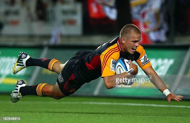 Gareth Anscombe of the Chiefs scores a try during the round three Super Rugby match between the Chiefs and the Cheetahs at Waikato Stadium on March 2...