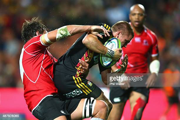 Gareth Anscombe of the Chiefs scores a try in the tackle of Franco Mostert of the Lions during the round 12 Super Rugby match between the Chiefs and...