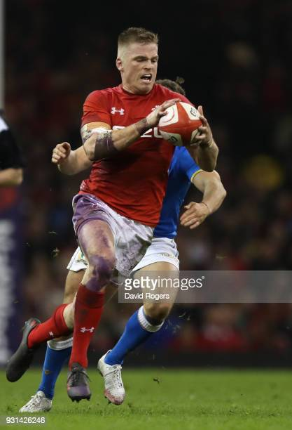 Gareth Anscombe of Wales breaks with the ball during the NatWest Six Nations match between Wales and Italy at the Principality Stadium on March 11...