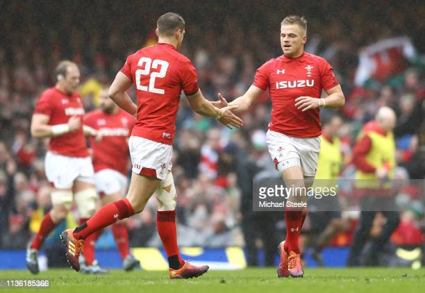 Gareth Anscombe of Wales celebrates kicking a penalty with Dan Biggar of Wales during the Guinness Six Nations match between Wales and Ireland at...