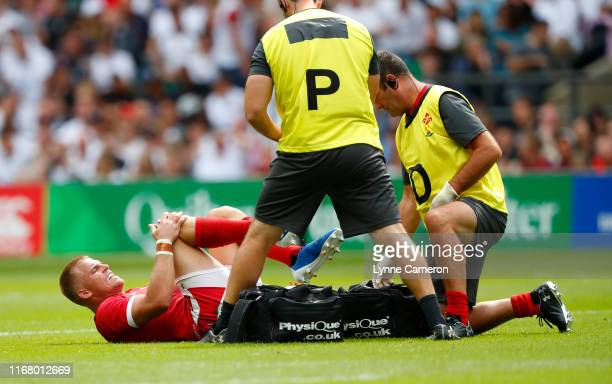 Gareth Anscombe of Wales goes off injured during the 2019 Quilter International between England and Wales at Twickenham Stadium on August 11, 2019 in...