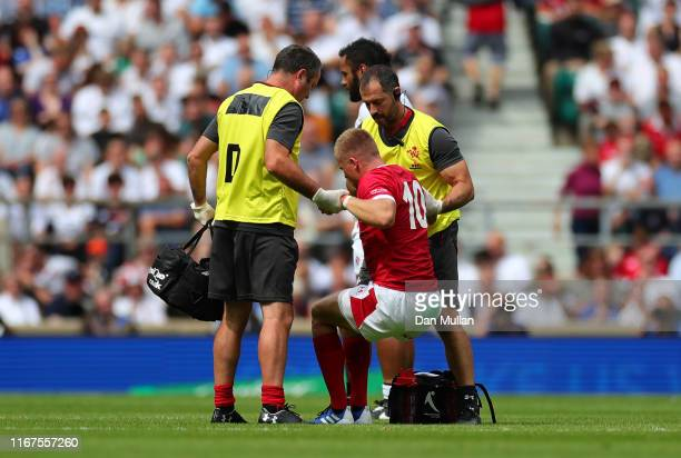Gareth Anscombe of Wales is helped off the field after suffering an injury during the 2019 Quilter International match between England and Wales at...