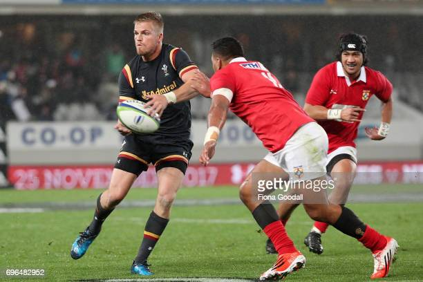 Gareth Anscombe of Wales is tackled by Cooper Vuna of Tonga during the International Test Match between Tonga and Wales at Eden Park on June 16 2017...