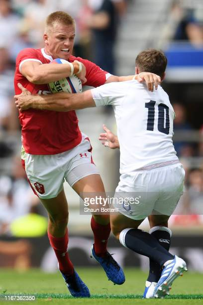 Gareth Anscombe of Wales is tackled by George Ford of England during the 2019 Quilter International match between England and Wales at Twickenham...