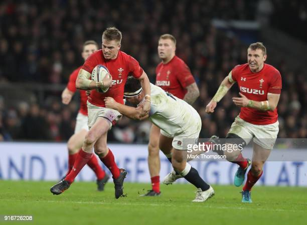 Gareth Anscombe of Wales is tackled by Jamie George of England during the NatWest Six Nations round two match between England and Wales at Twickenham...