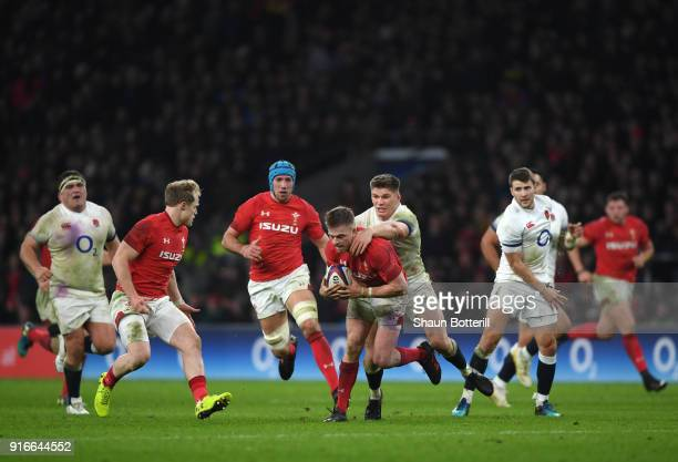 Gareth Anscombe of Wales is tackled by Owen Farrell of England during the NatWest Six Nations round two match between England and Wales at Twickenham...