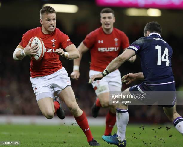Gareth Anscombe of Wales is tackled by Tommy Seymour during the NatWest Six Nations match between Wales and Scotland at the Principality Stadium on...