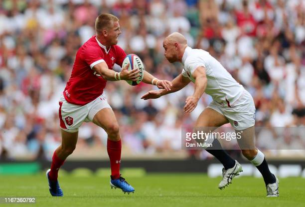 Gareth Anscombe of Wales is tackled by Willi Heinz of England during the 2019 Quilter International match between England and Wales at Twickenham...