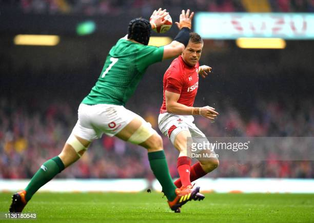 Gareth Anscombe of Wales kicks past Sean O'Brien of Ireland to set up the first Wales try during the Guinness Six Nations match between Wales and...