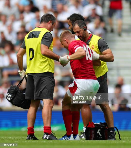 Gareth Anscombe of Wales receives medical treatment during the 2019 Quilter International match between England and Wales at Twickenham Stadium on...