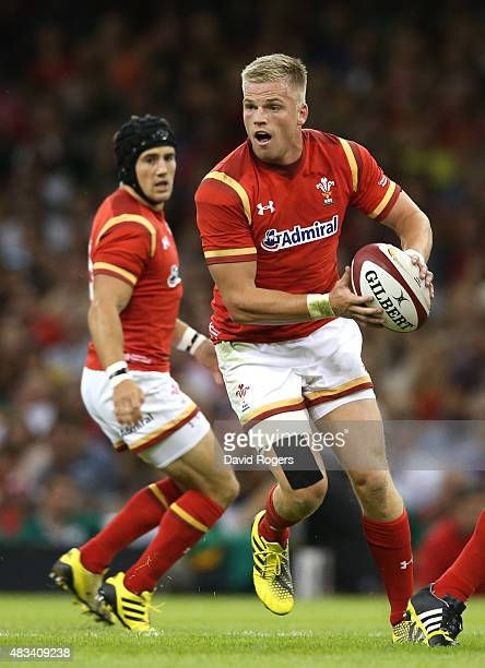 Gareth Anscombe of Wales runs with the ball during the International match between Wales and Ireland at the Millennium Stadium on August 8 2015 in...