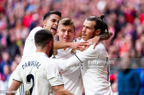 Gareth Bale #11 of Real Madrid celebrates after scoring his team's third goal during the La Liga match between Club Atletico de Madrid and Real...