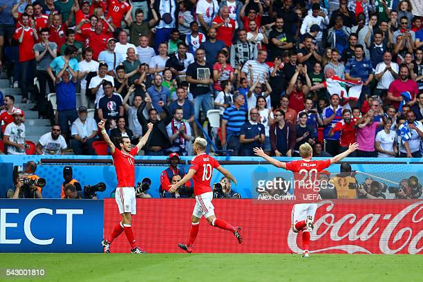 Gareth Bale Aaron Ramsey and Jonathan Williams of Wales celebrate their team's first goal during the UEFA EURO 2016 round of 16 match between Wales...