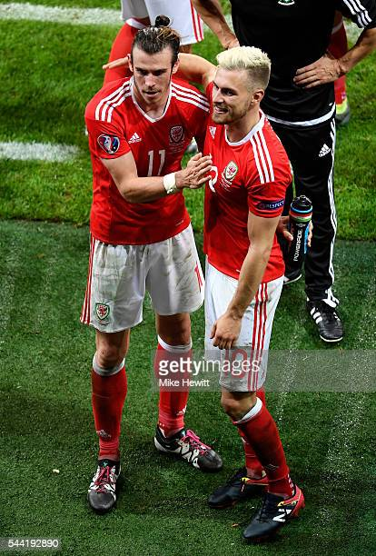 Gareth Bale and Aaron Ramsey of Wales celebrate after their team's 31 winafter the UEFA EURO 2016 quarter final match between Wales and Belgium at...