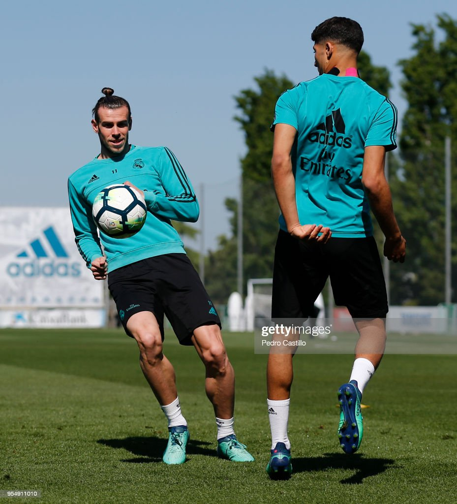 Gareth Bale (L) and Achraf Hakimi of Real Madrid in action during a training session at Valdebebas training ground on May 5, 2018 in Madrid, .
