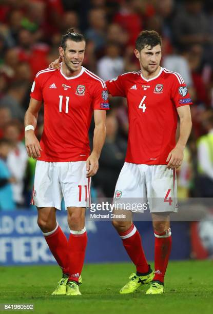 Gareth Bale and Ben Davies of Wales celebrate victory after the FIFA 2018 World Cup Qualifier between Wales and Austria at Cardiff City Stadium on...