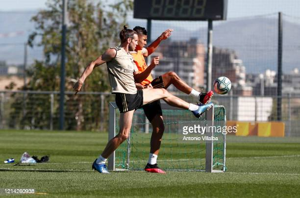 Gareth Bale and Casemiro of Real Madrid during the team's training session during the Covid-19 pandemic at Valdebebas training ground on May 20, 2020...