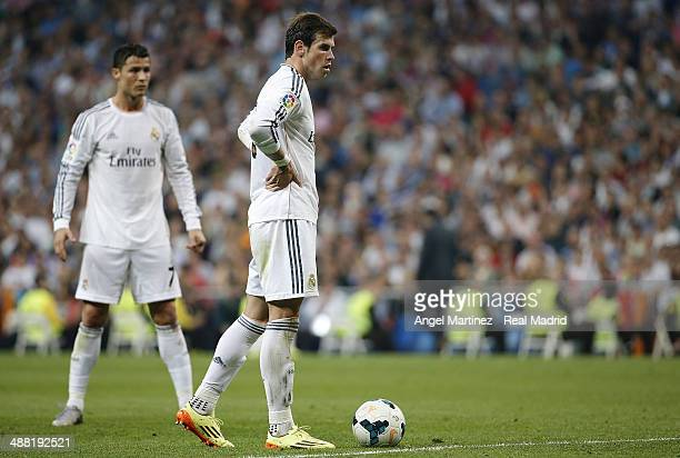 Gareth Bale and Cristiano Ronaldo of Real Madrid line up a free kick during the La Liga match between Real Madrid and Valencia CF at Estadio Santiago...