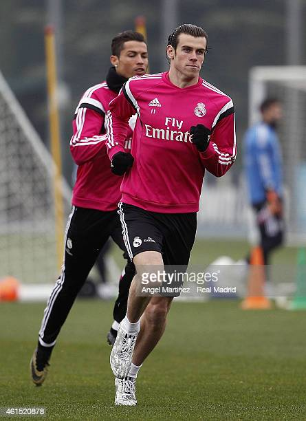 Gareth Bale and Cristiano Ronaldo of Real Madrid warm up during a training session at Valdebebas training ground on January 14 2015 in Madrid Spain