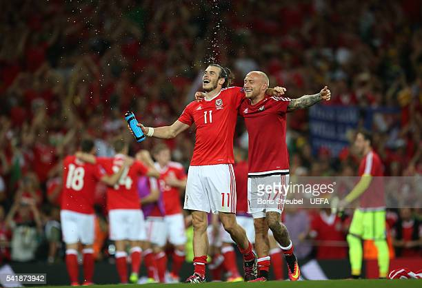 Gareth Bale and David Cotterill of Wales celebrate their team's 30 win in the UEFA EURO 2016 Group B match between Russia and Wales at Stadium...