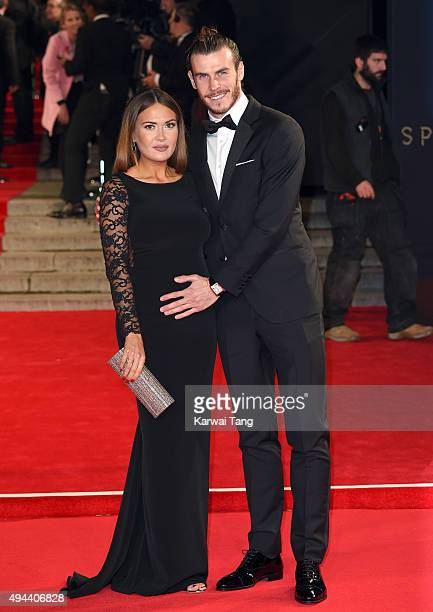 Gareth Bale and Emma RhysJones attend the Royal Film Performance of 'Spectre' at the Royal Albert Hall on October 26 2015 in London England