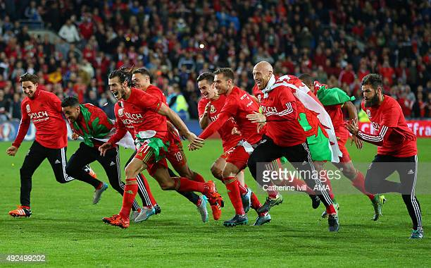 Gareth Bale and James Collins of Wales celebrate qualification with their team mates after the UEFA EURO 2016 Qualifier match between Wales and...