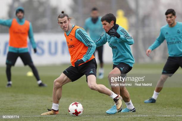 Gareth Bale and Jesus Vallejo of Real Madrid in action during a training session at Valdebebas training ground on January 9 2018 in Madrid Spain