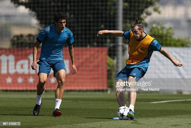 Gareth Bale and Jesus Vallejo of Real Madrid in action during a training session at Valdebebas training ground on May 22 2018 in Madrid Spain