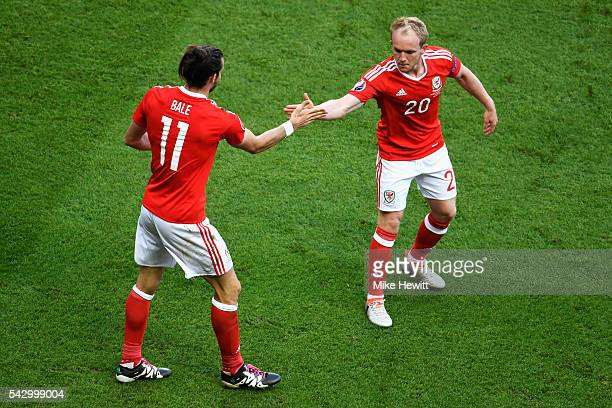 Gareth Bale and Jonathan Williams of Wales celebrate their team's first goal during the UEFA EURO 2016 round of 16 match between Wales and Northern...