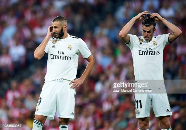 Gareth Bale and Karim Benzema of Real Madrid reacts during the La Liga match between Athletic Club Bilbao and Real Madrid at San Mames Stadium on...