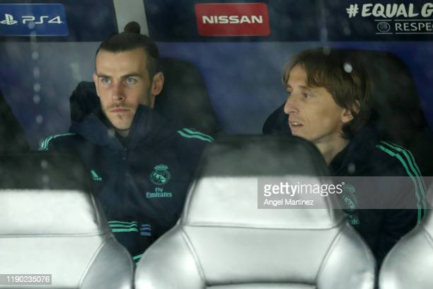 Gareth Bale and Luka Modric of Real Madrid look on from the bench prior to the UEFA Champions League group A match between Real Madrid and Paris...