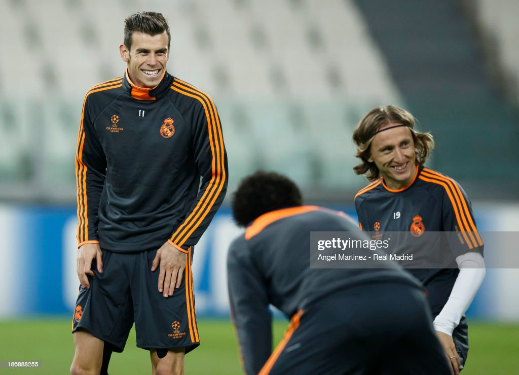 Gareth Bale (L) and Luka Modric of Real Madrid smile during a training session ahead of their UEFA Champions League Group B match against Juventus at Juventus Arena on November 4, 2013 in Turin, Italy.