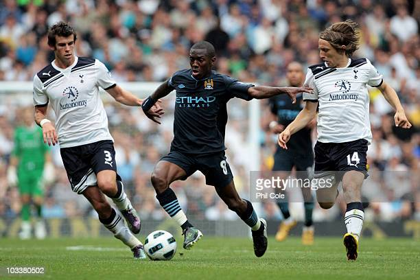 Gareth Bale and Luka Modric of Tottenham chase Shaun WrightPhillips of Manchester City during the Barclays Premier League match between Tottenham...
