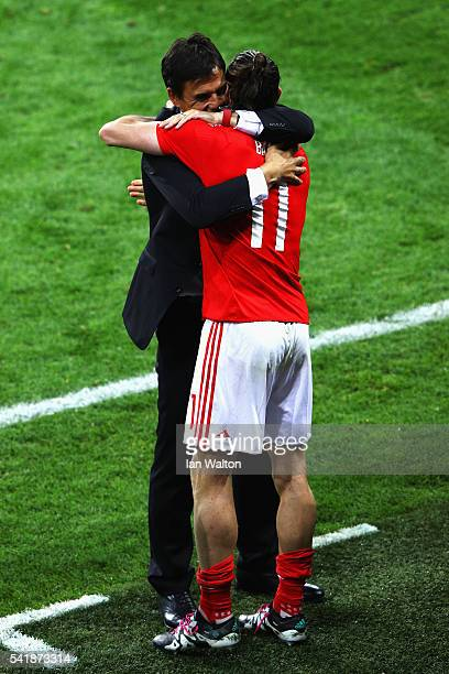 Gareth Bale and manager Chris Coleman of Wales celebrate their team's 30 win in the UEFA EURO 2016 Group B match between Russia and Wales at Stadium...