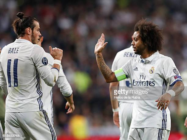 Gareth Bale and Marcelo of Real Madrid celebrate after scoring during the UEFA Champions League Group F match between Real Madrid CF and Legia...