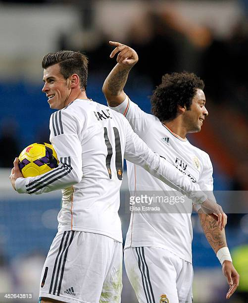 Gareth Bale and Marcelo of Real Madrid celebrate after the La Liga match between Real Madrid and Real Valladolid CF at Estadio Santiago Bernabeu on...