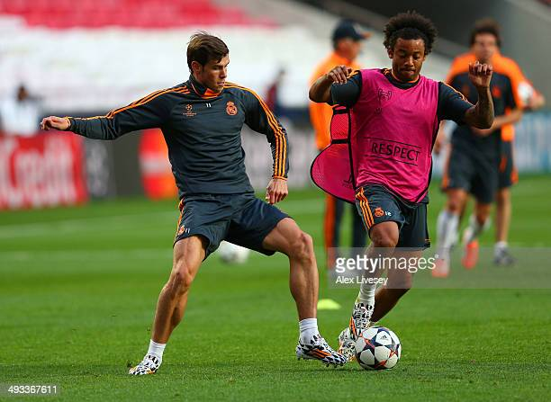 Gareth Bale and Marcelo of Real Madrid compete for the ball during a Real Madrid training session ahead of the UEFA Champions League Final against...