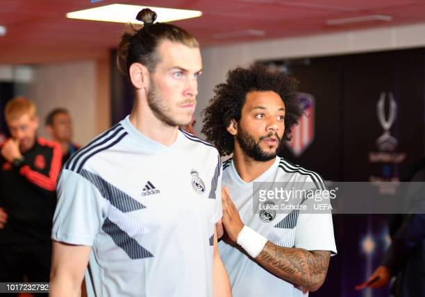 Gareth Bale and Marcelo of Real Madrid look on ahead of the UEFA Super Cup between Real Madrid and Atletico Madrid at Lillekula Stadium on August 15...