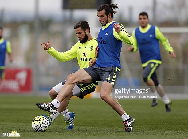 Gareth Bale and Nacho Fernandez of Real Madrid in action during a training session at Valdebebas training ground on May 13 2016 in Madrid Spain