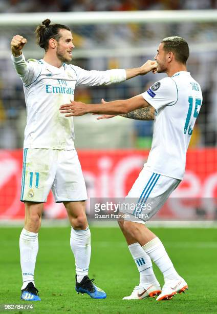 Gareth Bale and Theo Hernandez of Real Madrid celebrate following the UEFA Champions League Final between Real Madrid and Liverpool at NSC...