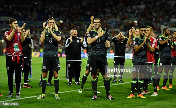 Gareth Bale and Wales players and staffs applaud the fans after their defeat in the UEFA EURO 2016 semi final match between Portugal and Wales at...