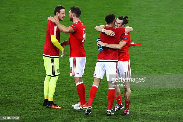 Gareth Bale and Wales players celebrate their team's 30 win after the UEFA EURO 2016 Group B match between Russia and Wales at Stadium Municipal on...