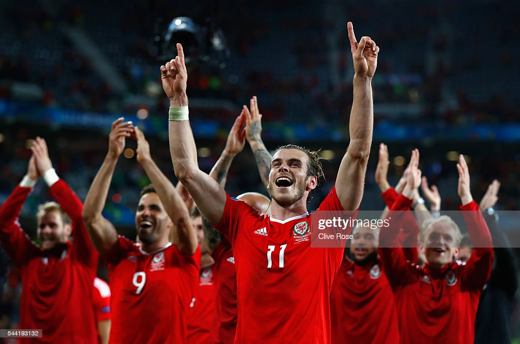 Gareth Bale (C) and Wales players celebrate their team's 3-1 win after the UEFA EURO 2016 quarter final match between Wales and Belgium at Stade Pierre-Mauroy on July 1, 2016 in Lille, France.