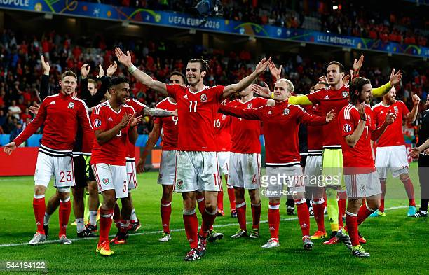 Gareth Bale and Wales players celebrate their team's 3-1 win after the UEFA EURO 2016 quarter final match between Wales and Belgium at Stade...