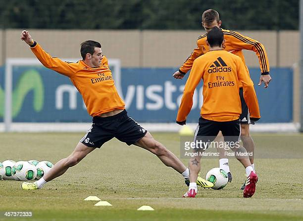 Gareth Bale Angel di Maria and Javier Llorente of Real Madrid in action during a training session at Ciudad Real Madrid on December 17 2013 in Madrid...