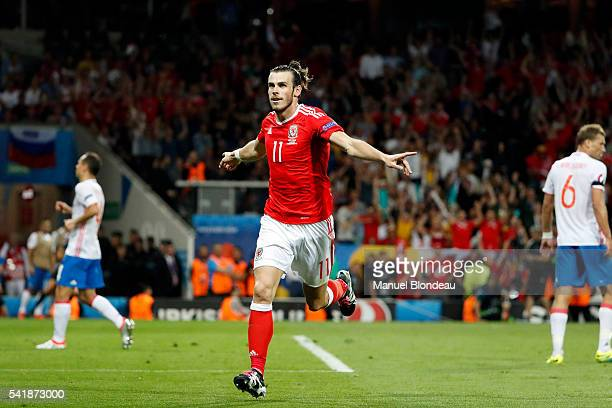 Gareth Bale celebrates scoring his goal during the UEFA EURO 2016 Group B match between Russia v Wales at Stadium Municipal on June 20 2016 in...