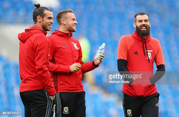 Gareth Bale Chris Gunter and Joe Ledley of Wales look on prior to the FIFA 2018 World Cup Qualifier between Wales and Austria at Cardiff City Stadium...